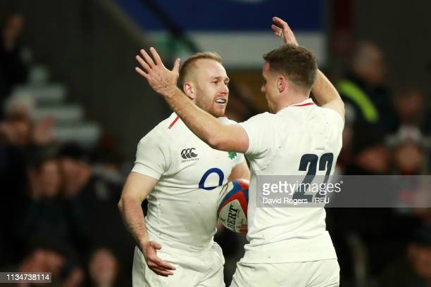 Dan Robson of England celebrates with teammate George Ford after scoring his team's seventh try during the Guinness Six Nations match between England...