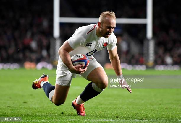 Dan Robson of England crosses to score their seventh try during the Guinness Six Nations match between England and Italy at Twickenham Stadium on...