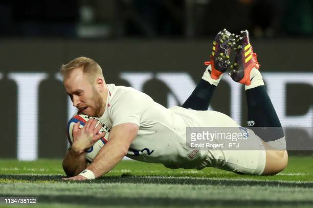Dan Robson of England scores his team's seventh try during the Guinness Six Nations match between England and Italy at Twickenham Stadium on March 09...