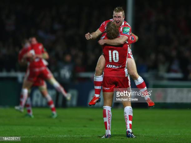 Dan Robson of Gloucester celebrates with Billy Twelvetrees at the final whistle after their sides 2722 victory during the Heineken Cup Pool six match...
