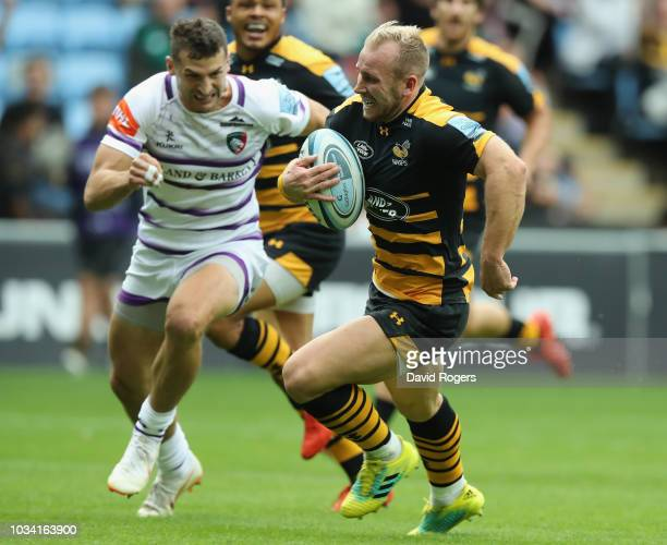 Dan Robson of Wasps breaks away from Jonny May during the Gallagher Premiership Rugby match between Wasps and Leicester Tigers at the Ricoh Arena on...