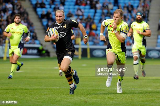 Dan Robson of Wasps breaks away to score his fourth try of the game during the Aviva Premiership match between Wasps and Sale Sharks at The Ricoh...