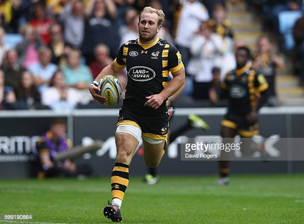 Dan Robson of Wasps breaks clear to score a try during the Aviva Premiership match between Wasps and Exeter Chiefs at the Ricoh Arena on September 4...