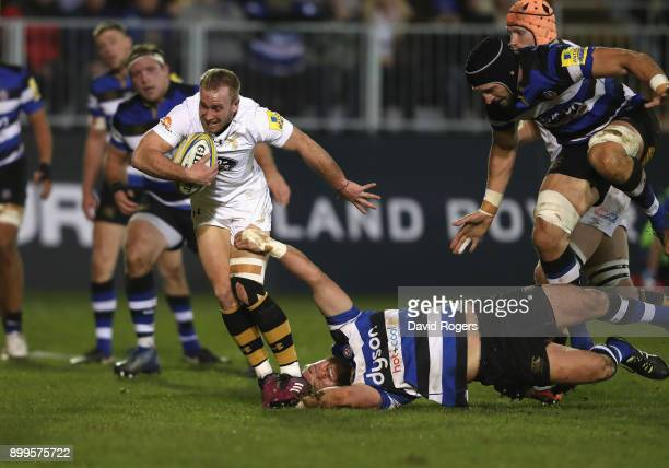 Dan Robson of Wasps breaks clear to score their second try during the Aviva Premiership match between Bath Rugby and Wasps at the Recreation Ground...