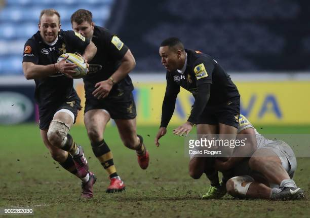 Dan Robson of Wasps breaks with the ball during the Aviva Premiership match between Wasps and Saracens at The Ricoh Arena on January 7 2018 in...