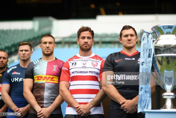 Dan Robson of Wasps Chris Ashton of Sale Sharks Mike Brown of Harlequins Danny Cipriani of Gloucester Rugby and Alex Goode of Saracens look on during...