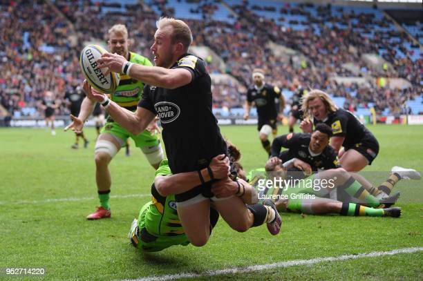 Dan Robson of Wasps is tackled by Piers Francis of Northampton Saints during the Aviva Premiership match between Wasps and Northampton Saints at The...