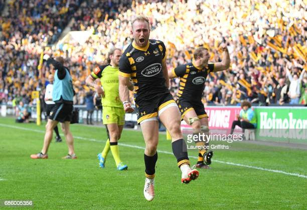 Dan Robson of Wasps jumps for joy on the fianl whistle after victory in the Aviva Premiership match between Wasps and Leicester Tigers at The Ricoh...
