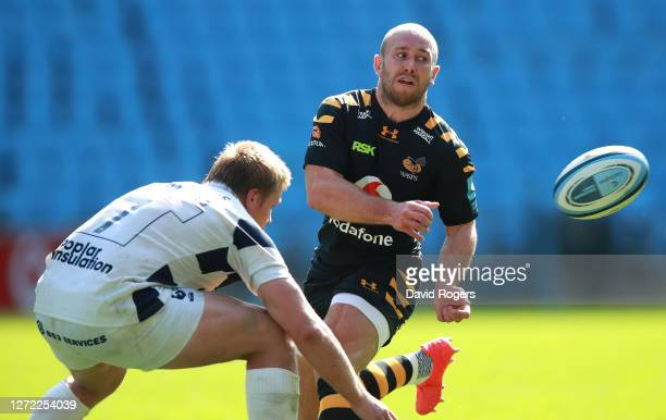 Dan Robson of Wasps off loads the ball as Dan Thomas tackles during the Gallagher Premiership Rugby match between Wasps and Bristol Bears at the...