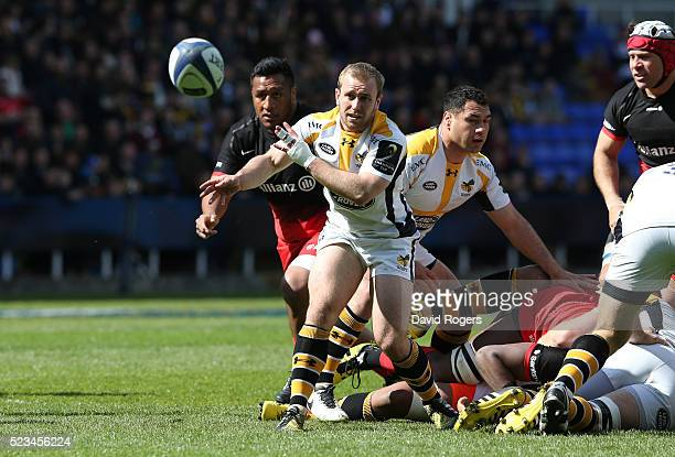 Dan Robson of Wasps passes the ball during the European Rugby Champions Cup semi final match between Saracens and Wasps at Madejski Stadium on April...