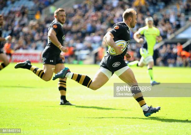 Dan Robson of Wasps runs through to score a try during the Aviva Premiership match between Wasps and Sale Sharks at The Ricoh Arena on September 2...