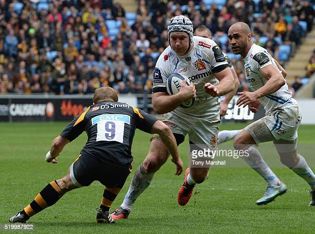 Dan Robson of Wasps tackles Tom Waldrom of Exeter Chiefs during the European Rugby Champions Cup Quarter Final match between Wasps and Exeter Chiefs...