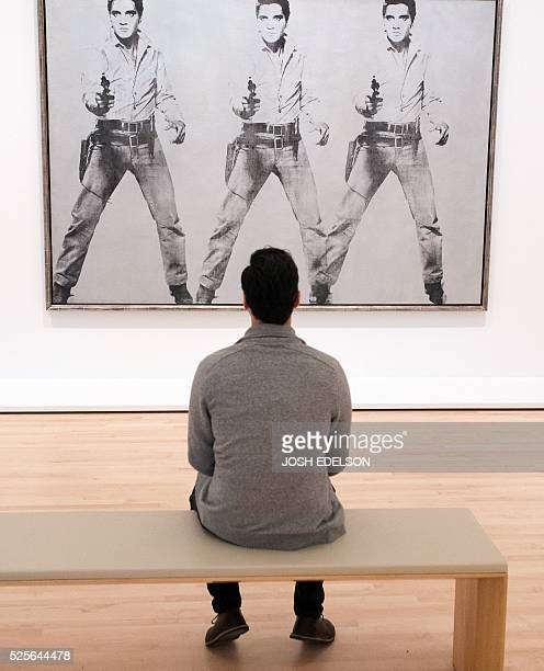 Dan Rosenbaum looks at an art piece entitled 'Triple Elvis' by Andy Warhol inside the San Francisco Museum of Modern Art in San Francisco California...