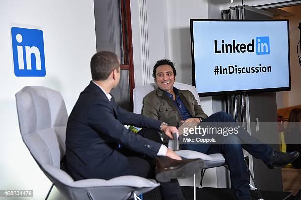 Dan Roth LinkedIn Executive Editor and Aasif Mandvi speak onstage at LinkedIn Discussion Series Executive Editor Dan Roth Interviews The Daily Show's...