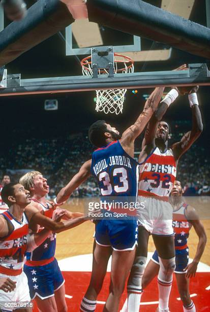 Dan Roundfield of the Atlanta Hawks and the East All Stars looks to get his shot off of Kareem AbdulJabbar of the Wes All Stars during the NBA All...