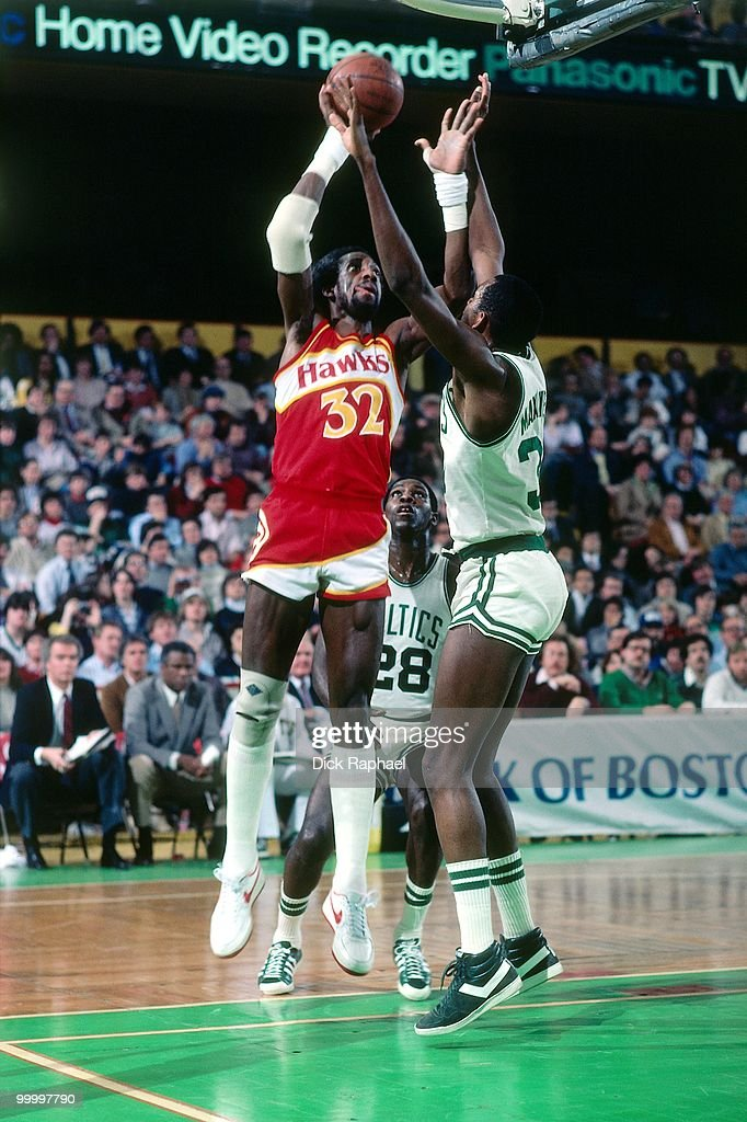 Dan Roundfield #32 of the Atlanta Hawks goes up for a shot against Cedric Maxwell #31 of the Boston Celtics during a game played in 1983 at the Boston Garden in Boston, Massachusetts.
