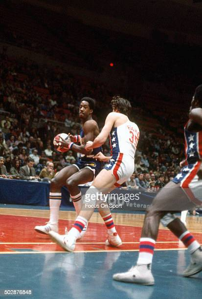 Dan Roundfield of the Indiana Pacers drives on Kim Hughes of the New Jersey Nets during an ABA basketball game circa 1975 at the Nassau Veterans...