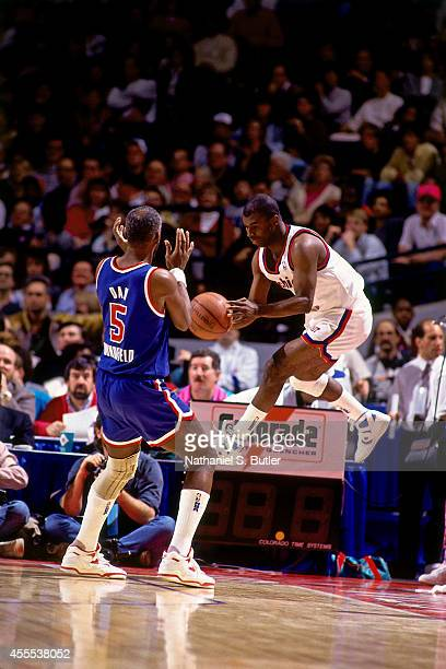 Dan Roundfield of the West Legends team defends against Phil Ford of the East Legends team during the Schick Legends Classic at AllStar Weekend in...