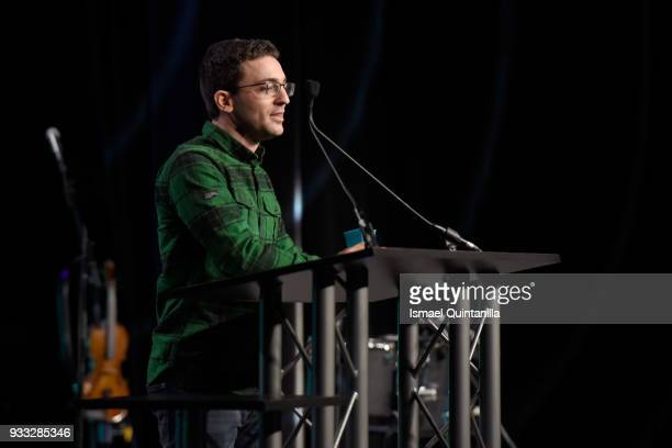 Dan Salvato accepts an award onstage at SXSW Gaming Awards during SXSW at Hilton Austin Downtown on March 17 2018 in Austin Texas