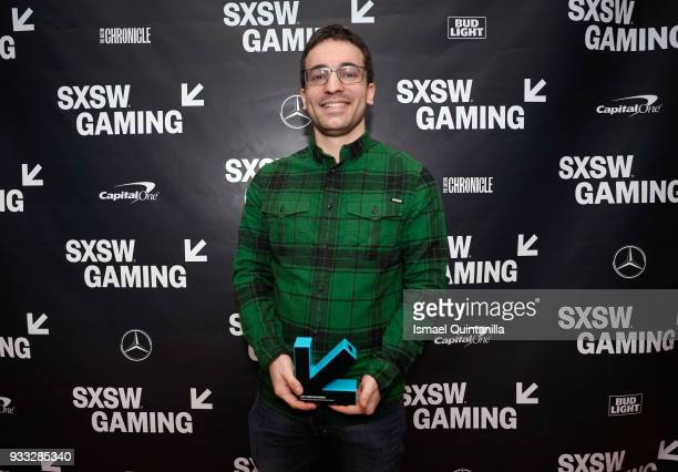 Dan Salvato poses with an award at SXSW Gaming Awards during SXSW at Hilton Austin Downtown on March 17 2018 in Austin Texas