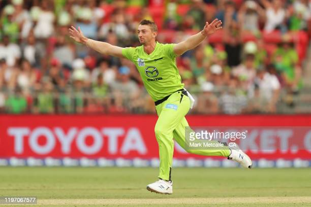 Dan Sams of the Thunder celebrates taking the wicket of Ben Dunk of the Stars during the Big Bash League match between the Sydney Thunder and the...