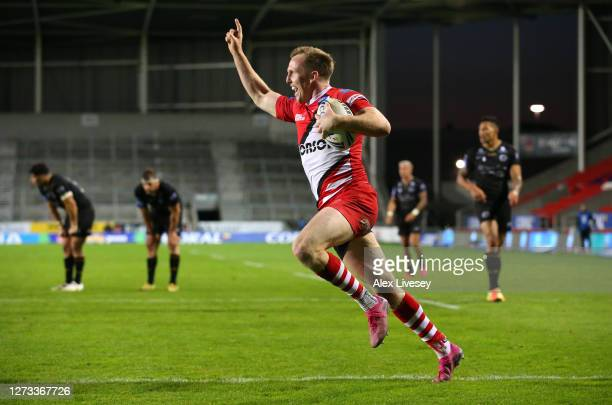 Dan Sargison of Salford Red Devils celebrates as he crosses the line to score a golden points try in extra time for victory over Catalans Dragons...