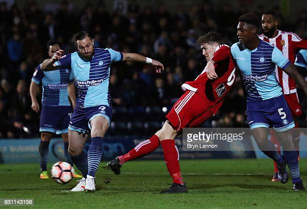 Dan Scarr of Stourbridge scores his sides first goal during the Emirates FA Cup Third Round match between Wycombe Wanderers and Stourbridge at Adams...
