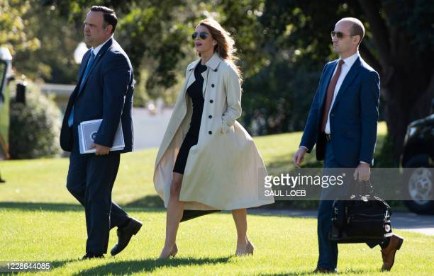 Dan Scavino , Director of White House Social Media, Hope Hicks, White House counselor, and Stephen Miller , White House senior advisor, walk to...