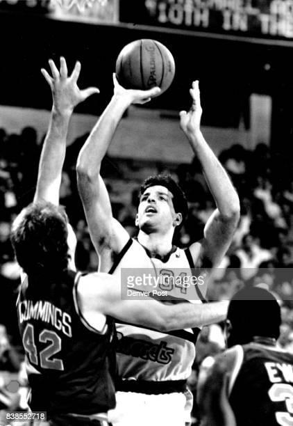 Dan Schayes shot over Pat Cummings and Patrick Ewing Credit The Denver Post