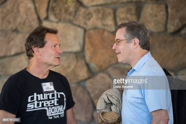 Dan Schulman president and chief executive officer of PayPal talks with Jonathan Nelson founder of Providence Equity Partners as they arrive at the...
