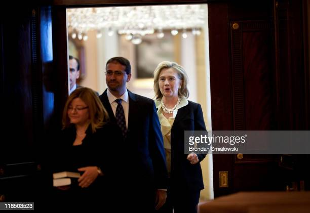 Dan Shapiro arrives with his wife Julie Fisher and Secretary of State Hillary Rodham Clinton for a swearingin ceremony at the State Department July 8...
