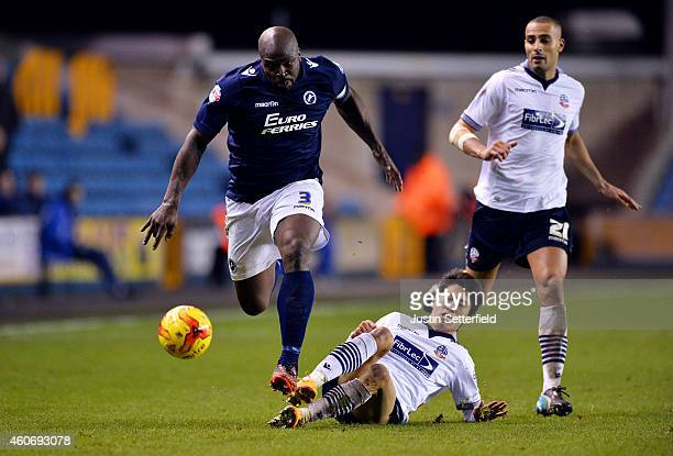 Dan Shittu of Millwall FC breaks past Lee ChungYong of Bolton during the Sky Bet Championship match between Millwall and Bolton Wanderers at The Den...