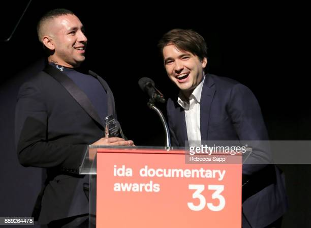 Dan Sickles and Antonio Santini pose with the Best Feature Award at the 33rd Annual IDA Documentary Awards at Paramount Theatre on December 9 2017 in...