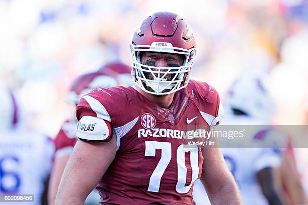 Dan Skipper of the Arkansas Razorbacks gets pumped up after play during a game against the Louisiana Tech Bulldogs at Razorback Stadium on September...