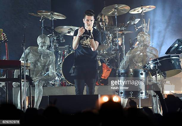 Dan Smith and drummer Chris Wood of the band Bastille perform onstage at 1067 KROQ Almost Acoustic Christmas 2016 Night 2 at The Forum on December 11...
