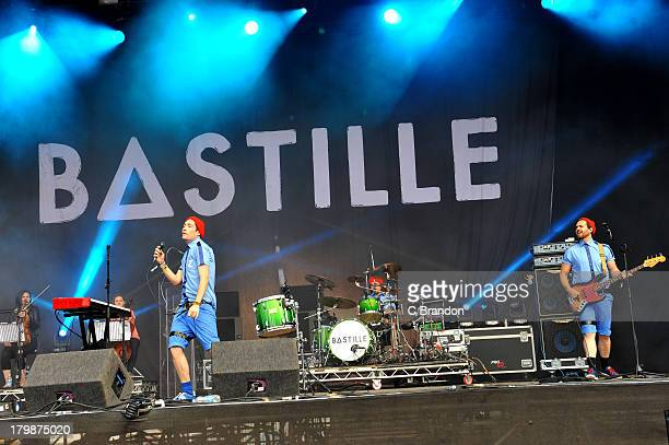 Dan Smith Chris 'Woody' Wood and Will Farquarson of Bastille perform on stage during Day 3 of Bestival 2013 at Robin Hill Country Park on September 7...
