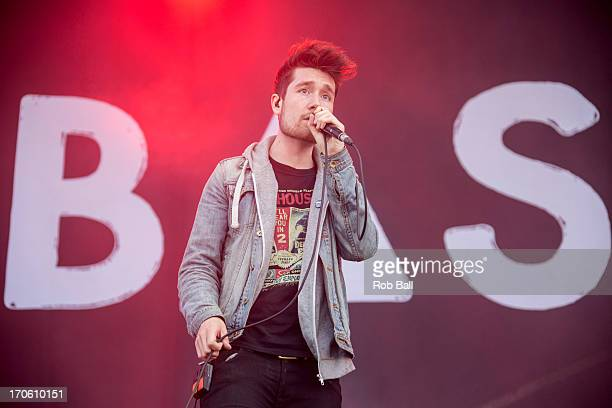 Dan Smith from Bastille performs on the main stage during day 3 of the Isle of Wight Festival at Seaclose Park on June 15 2013 in Newport Isle of...