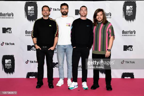 Dan Smith Kyle J Simmons Will Farquarson and Chris Wood of Bastille pose in the Winners room during the MTV EMAs 2018 at Bilbao Exhibition Centre on...