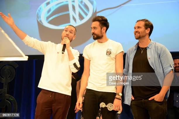 Dan Smith Kyle Simmons and Will Farquarson of Bastille winners of the Sky Best Group Award on stage during the Nordoff Robbins' O2 Silver Clef Awards...