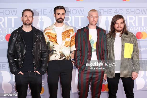 Dan Smith Kyle Simmons Will Farquarson and Chris Woody Wood of Bastille attend The BRIT Awards 2020 at The O2 Arena on February 18 2020 in London...