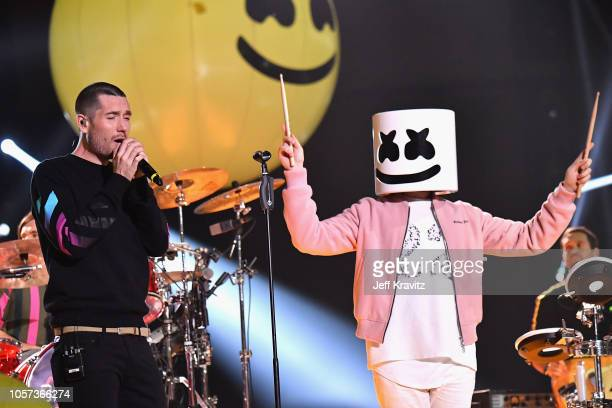 Dan Smith of Bastille and Marshmello perform on stage during the MTV EMAs 2018 on November 4 2018 in Bilbao Spain