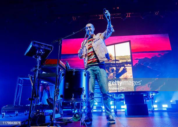 Dan Smith of Bastille performs on stage at Doug Mitchell Thunderbird Sports Centre on October 08 2019 in Vancouver Canada