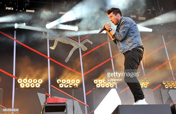 Dan Smith of Bastille performs on stage during the 1st Day of the Reading Festival Richfield Avenue on August 28, 2015 in Reading, England.