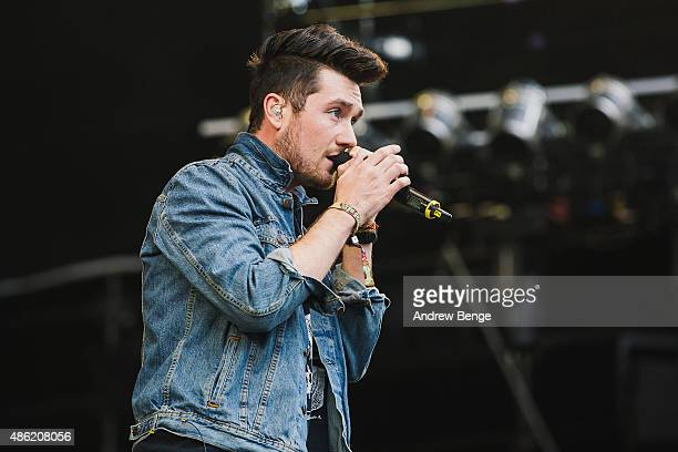 Dan Smith of Bastille performs on the main stage at Leeds Festival at Bramham Park on August 29 2015 in Leeds England