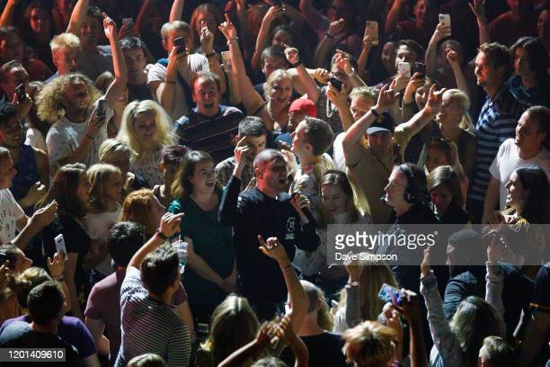 Dan Smith of Bastille sings from the crowd at Spark Arena on January 22 2020 in Auckland New Zealand