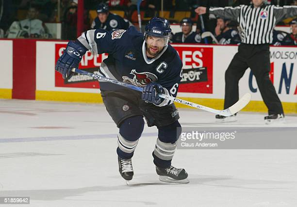 Dan Smith of the Edmonton Road Runners skates through the neutral zone during the American Hockey League game against the Hamilton Bulldogs at the...