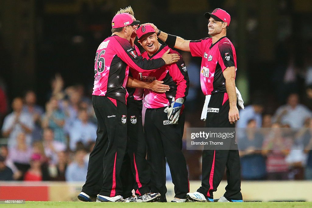 Dan Smith of the Sixers celebrates with team mates after running out Ben Laughlin of the Hurricanes during the Big Bash League match between the Sydney Sixers and the Hobart Hurricanes at SCG on January 15, 2014 in Sydney, Australia.