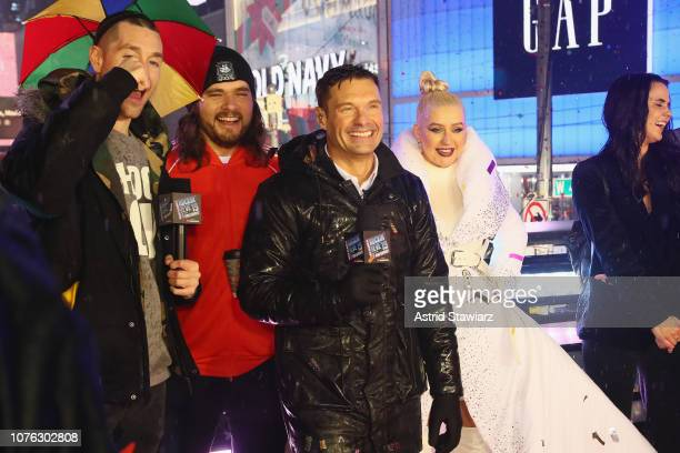 Dan Smith Ryan Seacrest and Christina Aguilera speak on stage during Dick Clark's New Year's Rockin' Eve With Ryan Seacrest 2019 on December 31 2018...
