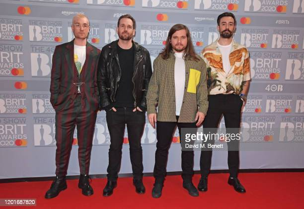 Dan Smith Will Farquarson Chris Wood and Kyle J Simmons of Bastille attend The BRIT Awards 2020 at The O2 Arena on February 18 2020 in London England