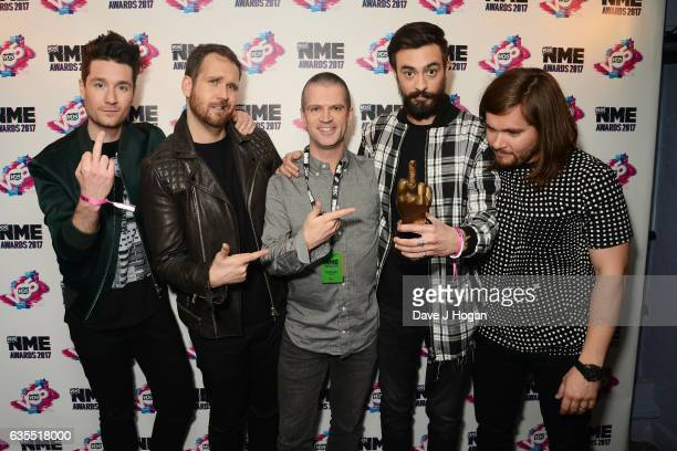 Dan Smith Will Farquarson Kyle Simmons and Chris Wood of Bastille pose in the winners room at the VO5 NME Awards 2017 at The O2 Academy Brixton on...